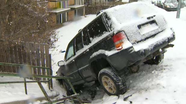 SUV crashes into a walkway at 9 St and Cameron Ave S.W.