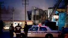 Emergency crews are shown outside Neptune Technolo