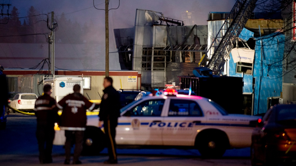 Emergency crews are shown outside Neptune Technologies in Sherbrooke, Que., Thursday, Nov. 8, 2012 where a large explosion at the plant sent a number of people to hospital with serious injuries. (Graham Hughes /  THE CANADIAN PRESS)