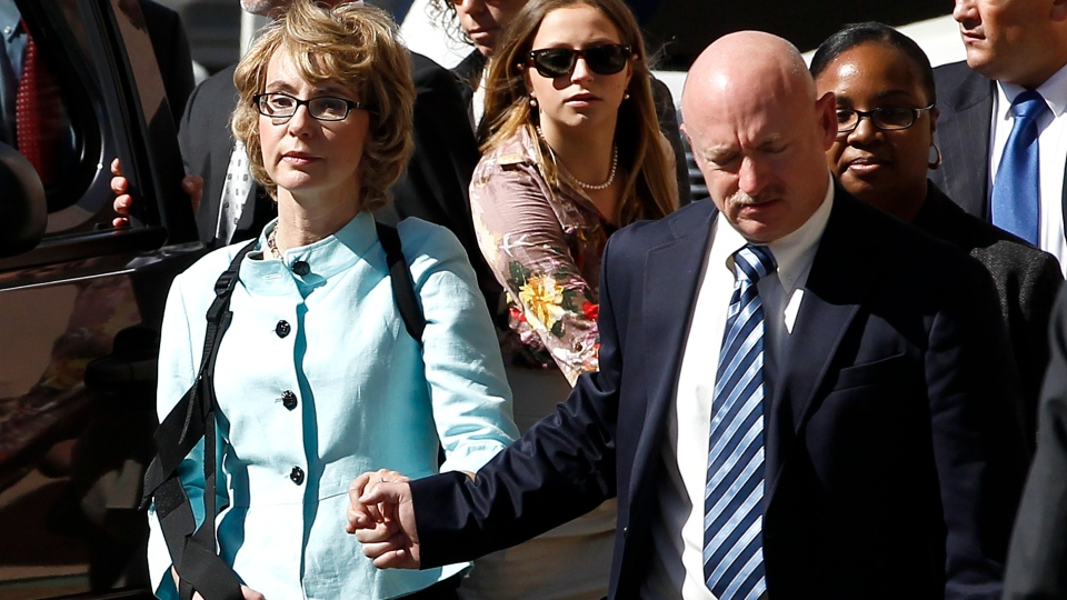 Former Democratic Rep. Gabrielle Giffords, left, and her husband Mark Kelly leave after the sentencing of Jared Loughner, in back of U.S. District Court in Tucson, Ariz., Thursday, Nov. 8, 2012. (AP / Ross D. Franklin)