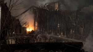 Fire burns at the Neptune Technologies & Bioressources plant in Sherbrooke, Que., Thursday, Nov. 8, 2012. (Graham Hughes /  THE CANADIAN PRESS)