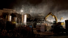 Smoke billows from the Neptune Technologies & Bior
