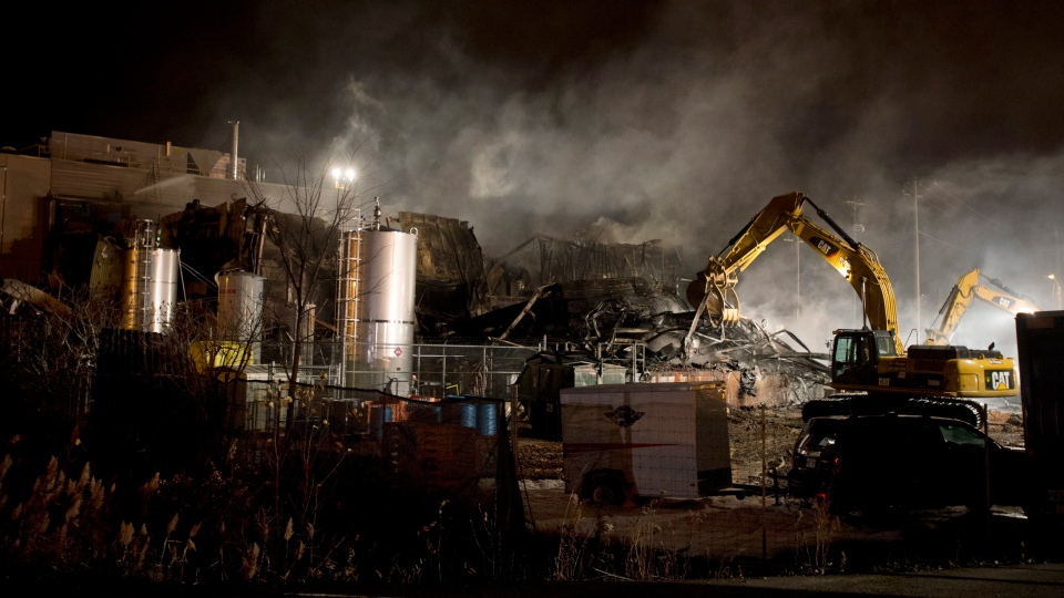 Smoke billows from the Neptune Technologies & Bioressources plant in Sherbrooke, Que., Thursday, Nov. 8, 2012. (Graham Hughes / THE CANADIAN PRESS)