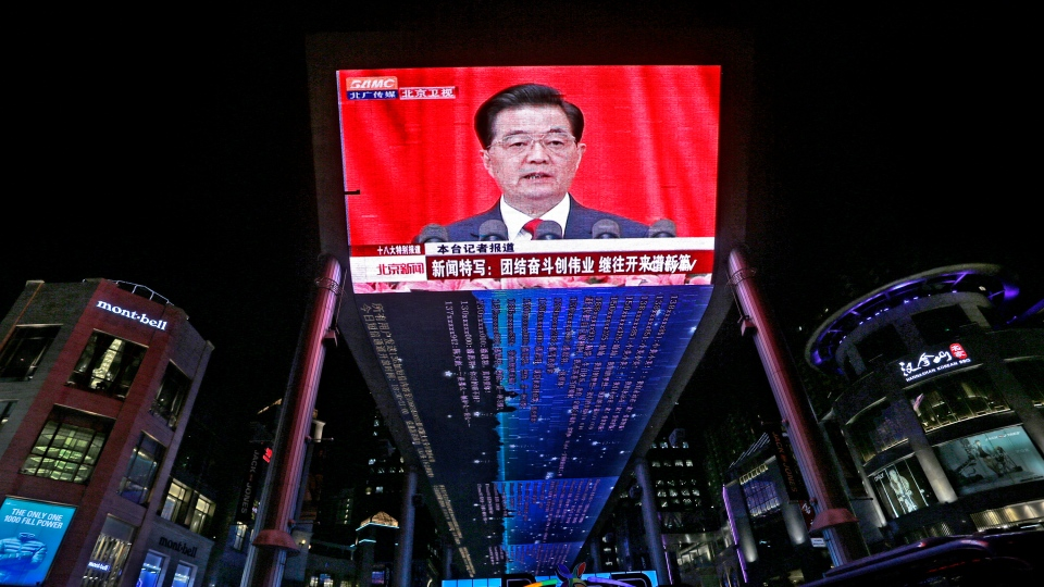 A huge screen shows a broadcast of Chinese President Hu Jintao speaking at the opening session of the 18th Communist Party Congress at the Great Hall of the People in Beijing, China, Thursday, Nov. 8, 2012. (AP / Vincent Yu)