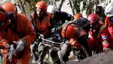 Rescuers carry body of Guatemala quake victim