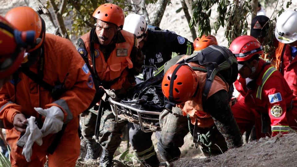 Rescue workers carry the body of a person who was killed during an earthquake in Barranca Grande, Guatemala, Thursday, Nov. 8, 2012. (AP / Guatemala's Presidential Press Office, Edwin Bercian)