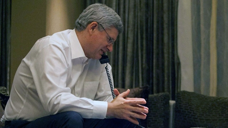 Prime Minister Stephen Harper speaks on the phone from Bangalore, India on Thursday, Nov. 8, 2012. (Prime Minister's Office)