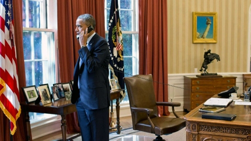 Reelected U.S. President Barack Obama speaks on the phone in the Oval Office in Washington on Thursday, Nov. 8, 2012. (White House photo)