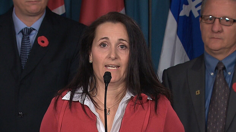 Tracy Kerr, the wife of Cpl. William Kerr, speaks to media in Ottawa on Thursday, Nov. 8, 2012.