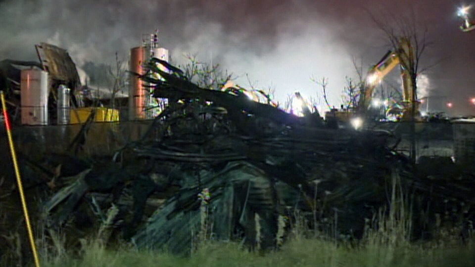 Crews move the rubble on the site of a factory that exploded in Sherbrooke, Que. on Thursday, Nov. 8, 2012.