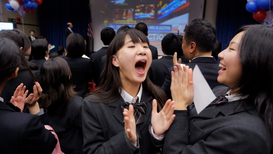 Japanese high-school students celebrate reports that President Barack Obama won the U.S. presidential election at the U.S. Embassy in Tokyo, Wednesday, Nov. 7, 2012. (AP / Itsuo Inouye)