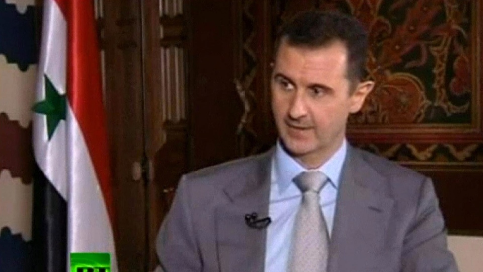 Syrian President Bashar Assad speaks with English-language television channel Russia Today recorded at an unknown date in Damascus, Syria, in this image made from video. (AP)