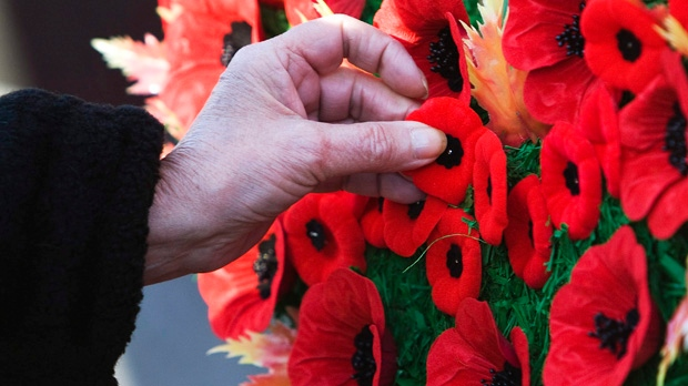 A woman places her poppy on a wreath during a Remembrance Day ceremony at the Queen's Park Veteran's Memorial in Toronto on Thursday, Nov. 11, 2010. (Nathan Denette / THE CANADIAN PRESS)