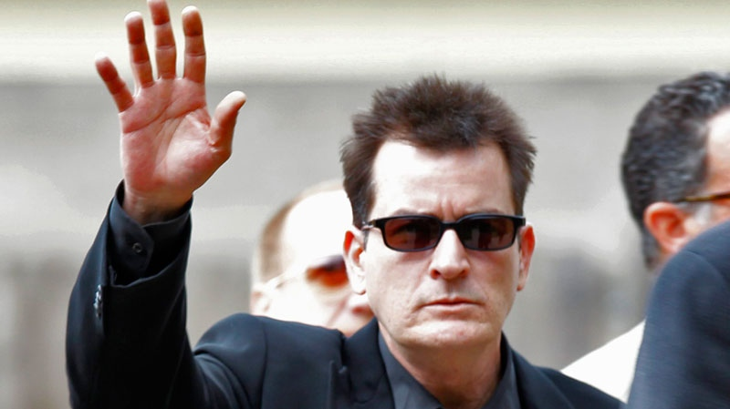 Charlie Sheen waves as he arrives at the Pitkin County Courthouse in Aspen, Colo., on Monday, Aug. 2, 2010, for a hearing in his domestic abuse case. (AP / Ed Andrieski)
