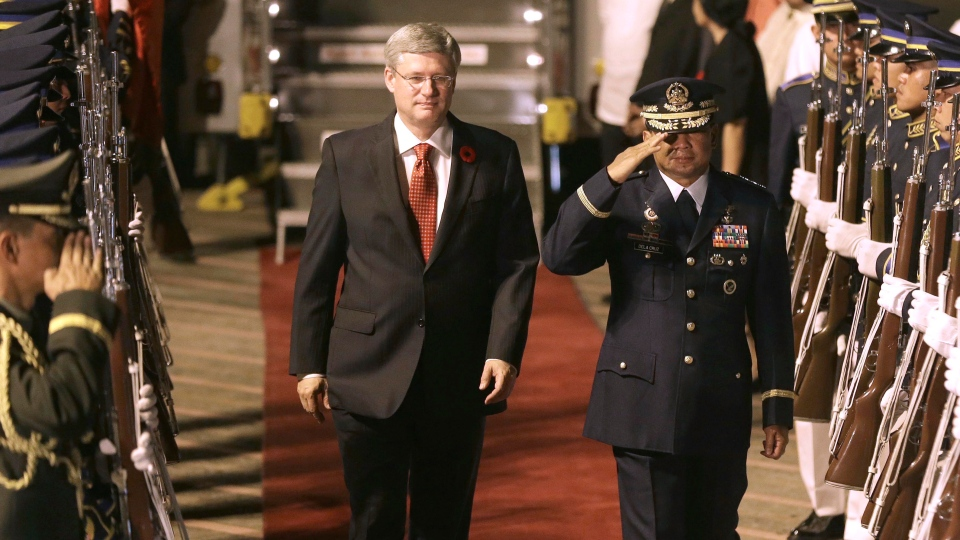 Prime Minister Stephen Harper, center left, reviews the troops upon arrival for an official visit at the Ninoy Aquino International Airport at suburban Pasay city south of Manila, Philippines, Friday Nov. 9, 2012.  (AP / Bullit Marquez)