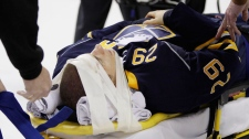 Buffalo Sabres' Jason Pominville is carted off the ice after a hit which resulted in a gash above his eye and a concussion during an NHL hockey game against the Chicago Blackhawks in Buffalo, N.Y. on Oct. 11, 2010. (AP / David Duprey)