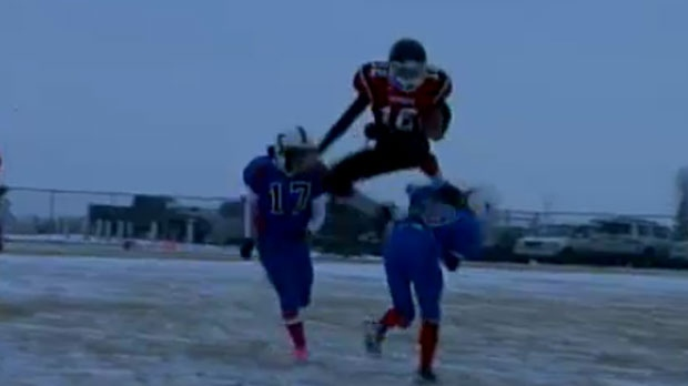 Cowboys QB Brad Taubert leaps over an unidentified defensive player