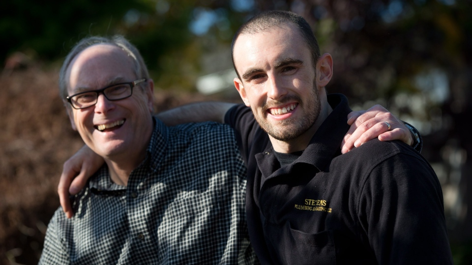 Jeffrey Moore, right, and his father Rick Moore pose for a photograph outside his parents' home in North Vancouver, B.C., on Friday November 9, 2012. (Darryl Dyck / THE CANADIAN PRESS)
