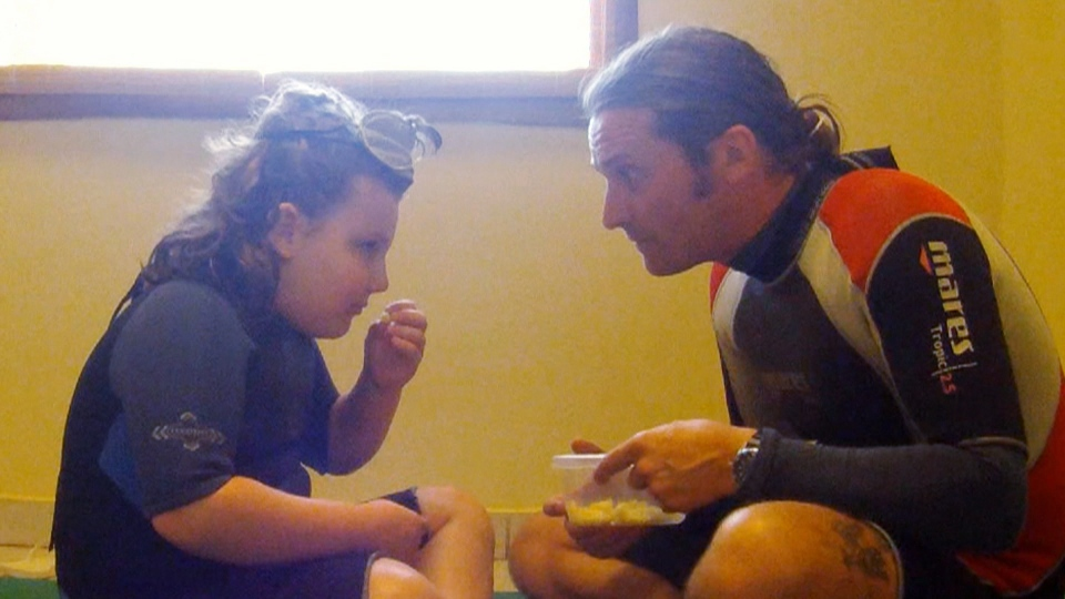 Alex Garrish is shown eating pasta during an intensive one-on-one therapy session with behaviour therapist Gerwin Bijker.