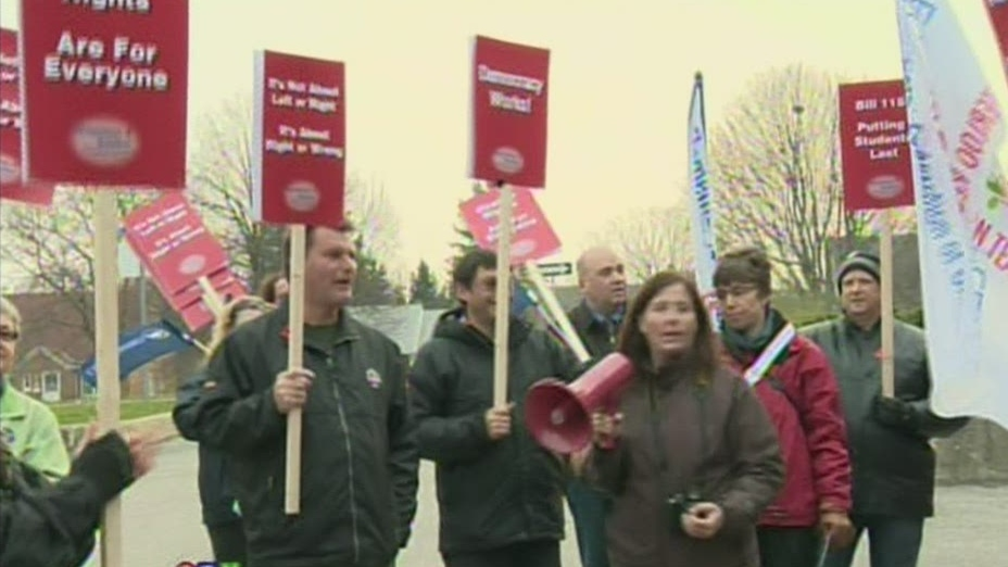 Teachers protest outside the office of Liberal MPP John Milloy in Kitchener, Ont. on Friday, Nov. 9, 2012.