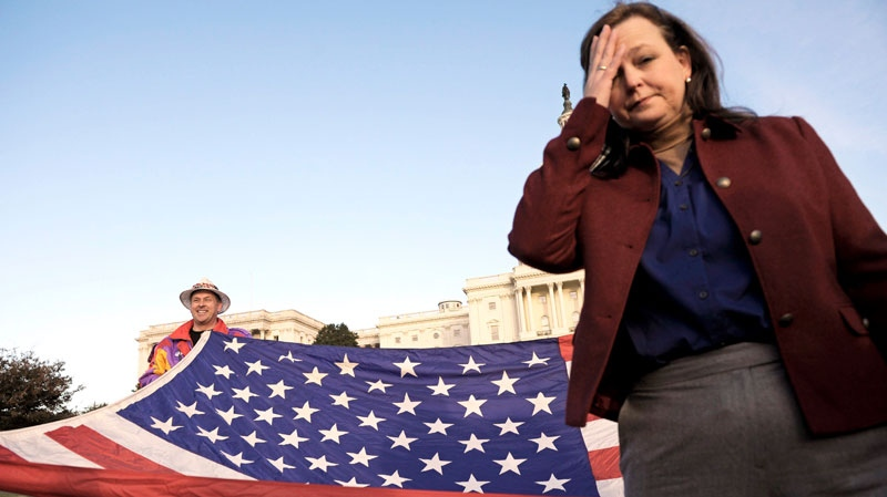 Tea Party Patriots co-founder Jenny Beth Martin pauses while organizing the start of an election day demonstration on the lawn of the Capitol in Washington, Tuesday, Nov. 2, 2010. (AP / Cliff Owen)
