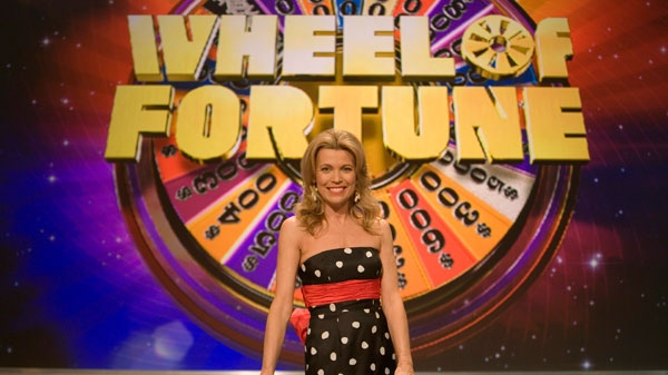 In this Jan 12, 2007, file photo, Vanna White, co-host of 'Wheel of Fortune,' poses on the set in North Charleston, S.C. (AP / Alice Keeney, file)