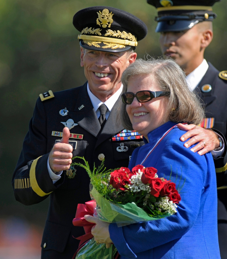 American CIA Director Gen. Davis Petraeus, standing with his wife Holly, participates in an armed forces farewell tribute and retirement ceremony in Arlington, Va., Aug. 31, 2011.  (AP / Susan Walsh)