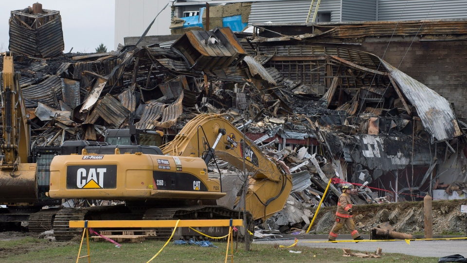 An emergency worker surveys the scene outside Neptune Technologies & Bioressources in Sherbrooke, Que., Friday, November 9, 2012. (Graham Hughes / THE CANADIAN PRESS)