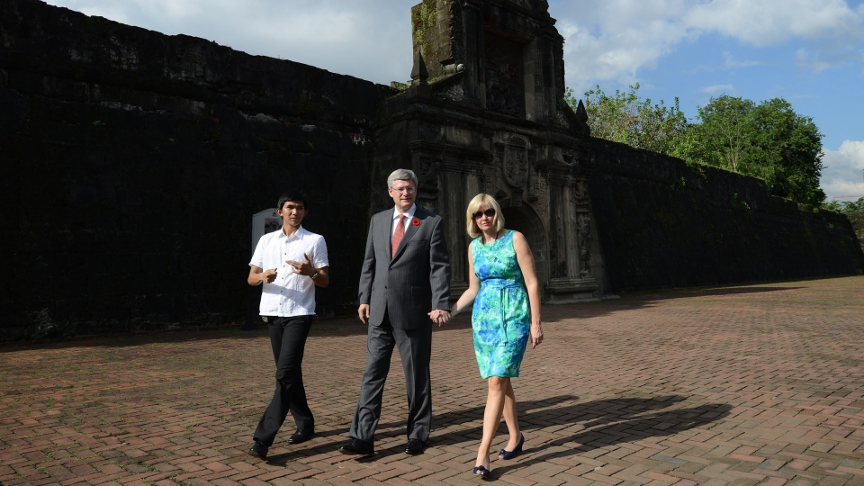 Prime Minister Stephen Harper and wife Laureen Harper are given a tour of Fort Santiago by Mikhail Camacho in Manila, Philippines on Saturday, November 10, 2012. (Sean Kilpatrick / THE CANADIAN PRESS)