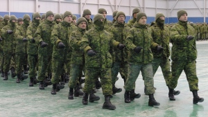 Troops headed to Afghanistan and Bosnia after a deployment ceremony at CFB Valcartier near Quebec City on Friday Jan. 9, 2004. (CP PHOTO/Clement Allard)