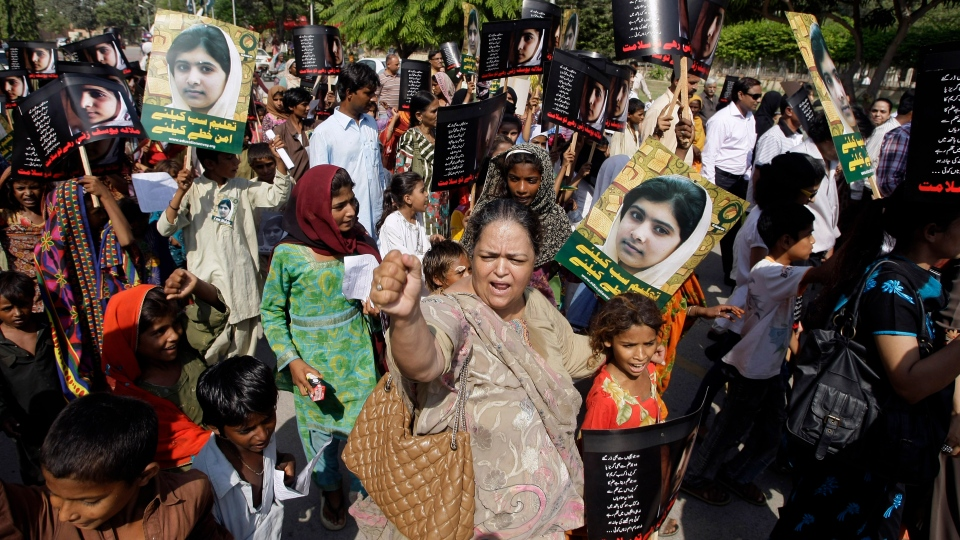 Pakistani students and teachers hold posters of 15-year-old Malala Yousufzai while they take part in a demonstration in Karachi, Pakistan on Saturday, Nov. 10, 2012. (AP / Faree Khan)