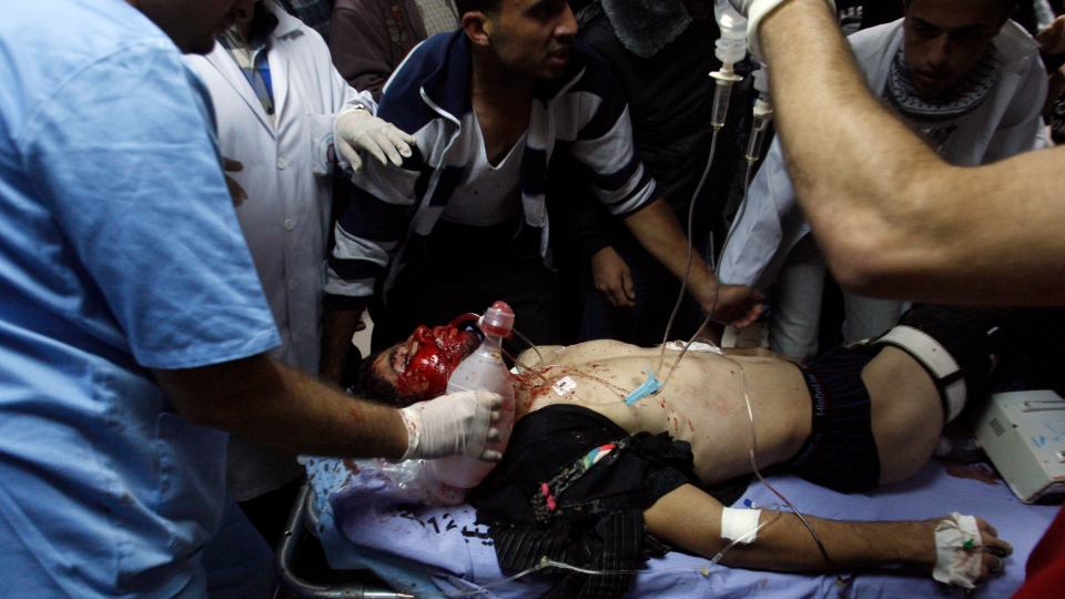 Palestinians bring a wounded man to a hospital in Gaza City, Saturday, Nov. 10, 2012. (AP / Hatem Moussa)