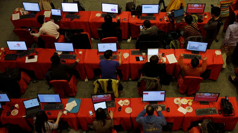 Journalists work at the media center setup for the 18th Communist Party Congress in Beijing, China, Saturday, Nov. 10, 2012. (AP / Ng Han Guan)