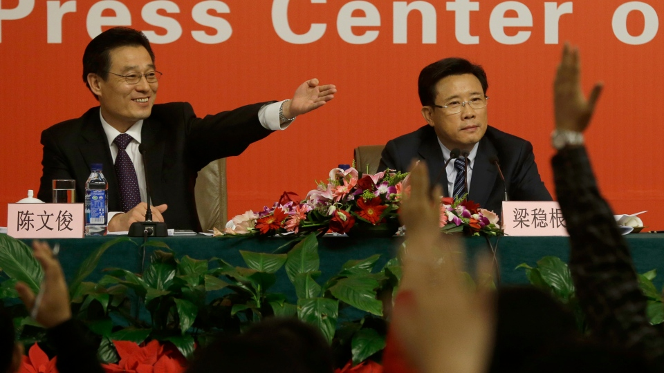 Moderator Chen Wenjun, left, invites questions from reporters next to Liang Wengen, Chairman of the board of the SANY Group at a press conference as part of the 18th Communist Party Congress at the media centre in Beijing, Saturday, Nov. 10, 2012. (AP / Ng Han Guan)