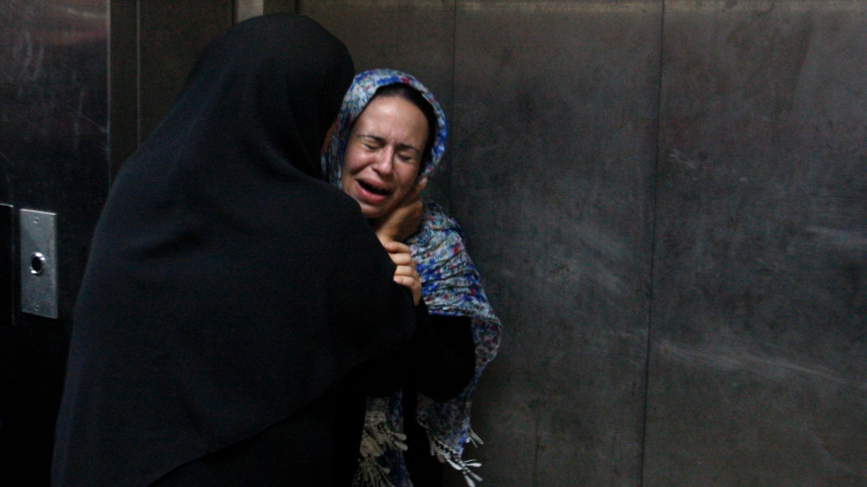 A Palestinian woman cries at a hospital in Gaza City, Saturday, Nov. 10,2012. (AP / Hatem Moussa)