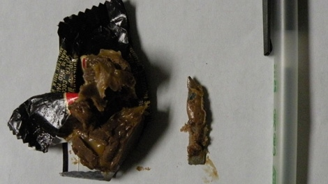 Police in Delta, B.C., south of Vancouver, are warning parents to check their children's Halloween candy carefully after a woman bit into a chocolate bar and found a razor blade inside. Nov. 3, 2010. (Handout)