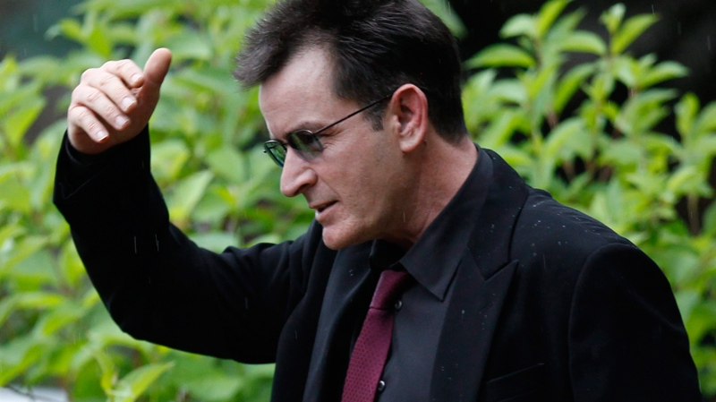 Charlie Sheen shields his face from the rain as he leaves the the Pitkin County Courthouse in Aspen, Colo., on Monday, Aug. 2, 2010. (AP / Ed Andrieski)
