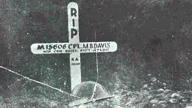 A photograph of Merle Davis' cross, and his helmet. This photo served as inspiration for Merle's son Rhett's song 'A Helmet & a Cross (in memory of the fallen).'