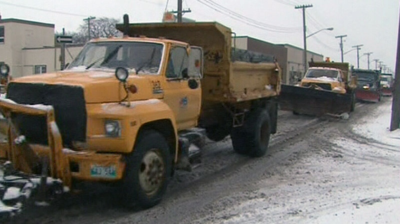 Snow plows line the street in preparation for a mass snowfall in Winnipeg on Saturday, Nov. 10, 2012.