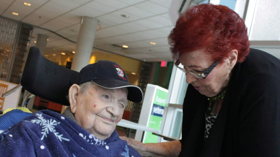 Dorothy Burnell, 86, talks to her husband George Burnell, 92, at Sunnybrook's Veterans Centre in Toronto where he lives on Sunday, Oct.28, 2012. (Colin Perkel / THE CANADIAN PRESS)