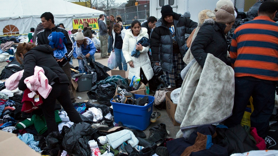 Residents search through donated clothing piles in the Rockaways, in the Queens borough of New York, Saturday, Nov. 10, 2012. (AP / John Minchillo)