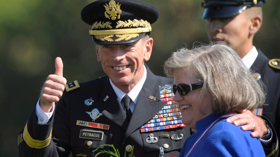 Former Commander of International Security Assistance Force and U.S. Forces-Afghanistan Gen. David Petraeus, stands with his wife Holly in Arlington, Va., Aug. 31, 2011. (AP / Susan Walsh)