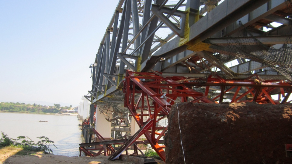 Structures of a bridge under construction across the Irrawaddy River, east of Shwebo, Myanmar are seen damaged after a strong earthquake on Sunday, Nov. 11, 2012.  (AP / Weekly Eleven News)