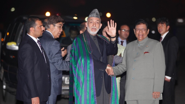 Hamid Karzai waves on Nov. 11, 2012.