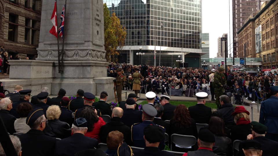 People gather in front of Old City Hall as a Remembrance Day ceremony is underway in Toronto on Sunday, Nov. 11, 2012. (Ashley Rowe / CTV Toronto)