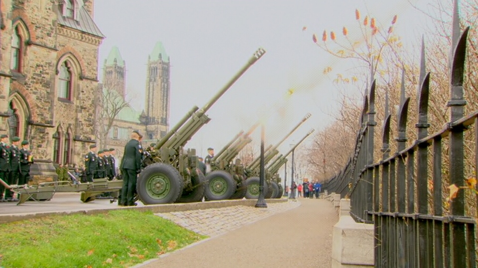 Blank rounds are fired from a howitzer artillery gun at a Remembrance Day ceremony being held at Parliament Hill in Ottawa on Sunday, Nov. 11, 2012.