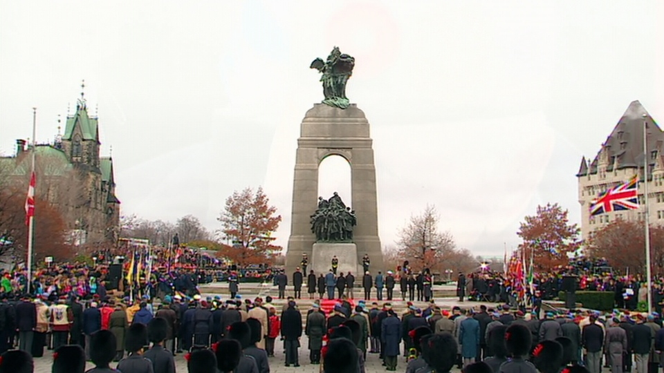 People attend a Remembrance Day ceremony being held at Parliament Hill in Ottawa on Sunday, Nov. 11, 2012.