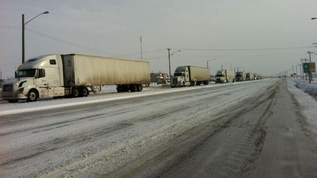As many as 100 semis lined Highway 1, waiting for it to reopen Sunday morning.
