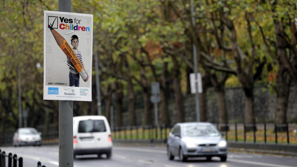 Yes posters decorate the street scene in North Dublin, Ireland, Friday, Nov. 9, 2012, before the historic referendum on upcoming Saturday to decide on increasing legal protection for children in Ireland. (AP / Peter Morrison)