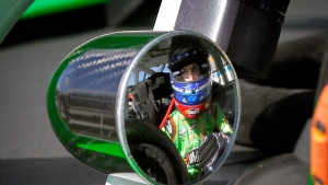 Driver Danica Patrick sits in her car after qualifying for the NASCAR Nationwide Series auto race, Saturday, Nov. 10, 2012, at Phoenix International Raceway in Avondale, Ariz. (AP / Matt York)